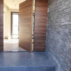 Pivot Door With Wall Paneling